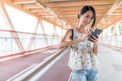 Woman using mobile phone in the city. Asian young woman Stock Photo