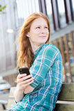 Woman Using Mobile Phone in a City Royalty Free Stock Photography
