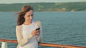 Woman Using Mobile Phone On Deck Of Cruise Ship Stock Footage - How to use cell phone on cruise ship