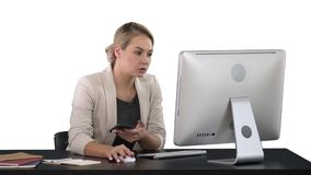 Woman Using Mobile Phone At Desk, white background. Professional shot in 4K resolution. 007. You can use it e.g. in your commercial video, business stock footage