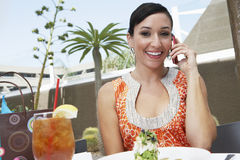 Woman Using Mobile Phone While Having Refreshments Stock Photos