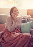 Woman using a mobile phone at home. stock image