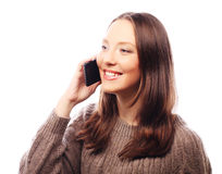 Woman using a mobile phone isolated on a white background Royalty Free Stock Photos