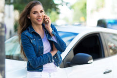 Woman using mobile phone near car Royalty Free Stock Image