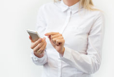 Woman using mobile phone Stock Photography