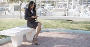 Woman Using Mobile Phone Outdoor. Businesswoman working with a mobile phone in the street stock video