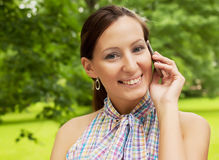 Woman using mobile phone outdoors Royalty Free Stock Image
