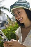 Woman using mobile phone outdoors Stock Images
