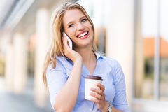 Woman using mobile phone outdoors Royalty Free Stock Photos