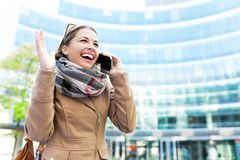 Woman using mobile phone outdoors Royalty Free Stock Images