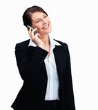 Woman using mobile phone over white background Stock Photos