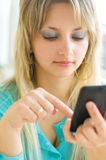Woman using mobile phone. Pretty young woman using mobile phone Stock Photography