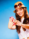 Woman using mobile phone reading sms or texting. Technology and internet. Happy woman using cellphone texting on mobile phone. Teen girl reading sms on stock images