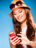 Woman using mobile phone reading sms or texting Stock Photography