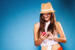 Woman using mobile phone reading sms or texting Royalty Free Stock Images