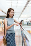 Woman using the mobile phone Royalty Free Stock Photos