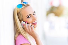 Woman using mobile phone Stock Photos