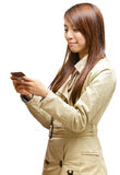 Woman using mobile phone sms Royalty Free Stock Photos