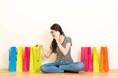 Woman using mobile phone talking with friends Royalty Free Stock Image