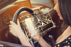 Woman using mobile phone to find directions while driving a car Royalty Free Stock Photo