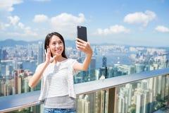 Woman using mobile phone to take photo in Hong Kong Royalty Free Stock Photo