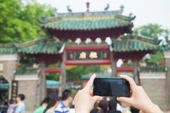 Woman using a mobile phone to take photos Stock Photo