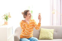 Woman using mobile phone for video chat stock photo