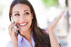 Woman using mobile phone Royalty Free Stock Images