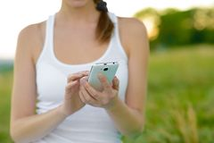 Woman Using Mobile Smart Phone Outdoors Royalty Free Stock Photo