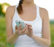 Woman Using Mobile Smart Phone Outdoors Royalty Free Stock Image