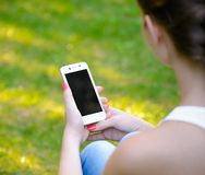 Woman Using Mobile Smart Phone Outdoors Stock Photo