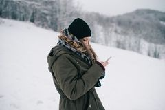 Woman using mobile smartphone royalty free stock photos