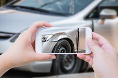 Woman using mobile smartphone take photo car crash accident royalty free stock images