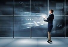 Woman using modern technologies Royalty Free Stock Image