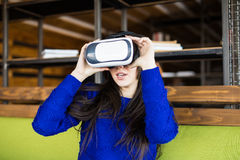 Woman using modern virtual reality glasses Stock Images