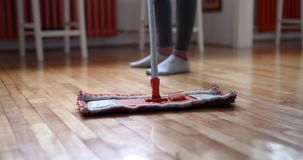Woman using mop cleaner to do household chores faster. And tidy home stock photos