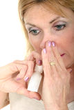 Woman Using Nasal Spray with Hand Royalty Free Stock Images