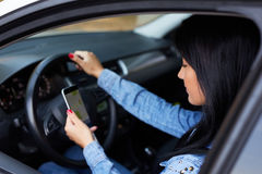 Woman using navigation app on smartphone stock photo