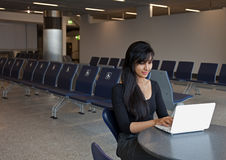 Woman Using Notebook in the Airport Terminal Stock Photography