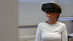 Woman using oculus rift in college stock footage