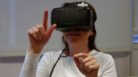 Woman using oculus rift in college stock video footage