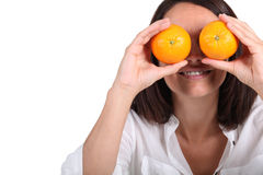 Woman using oranges for eyes Royalty Free Stock Photos