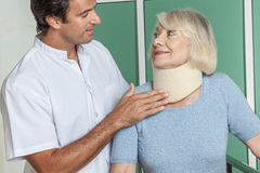 Woman using a orthopedic neck.  Royalty Free Stock Image