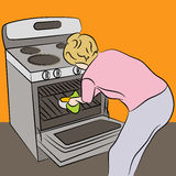Woman Using Oven Royalty Free Stock Photo