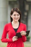 Woman using pad Stock Image