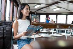 Woman using paper city map and taking ferry in Hong Kong city. Asian young woman Stock Photography