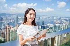 Woman using paper map in Hong Kong Royalty Free Stock Photography