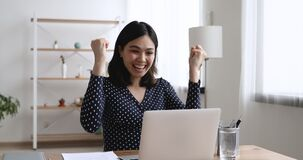 Woman using pc receive great news celebrating moment of victory