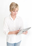 Woman using a PC tablet Stock Image