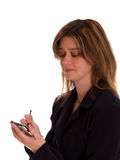 Woman using a pda Stock Photos